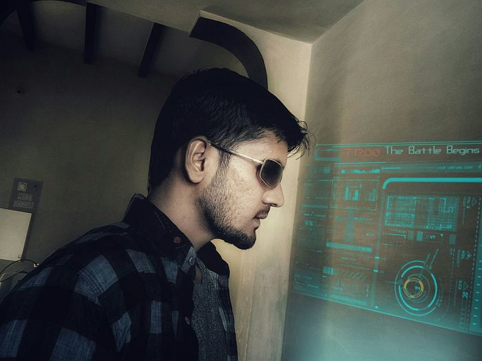 Side View Of Young Man Looking At Interface