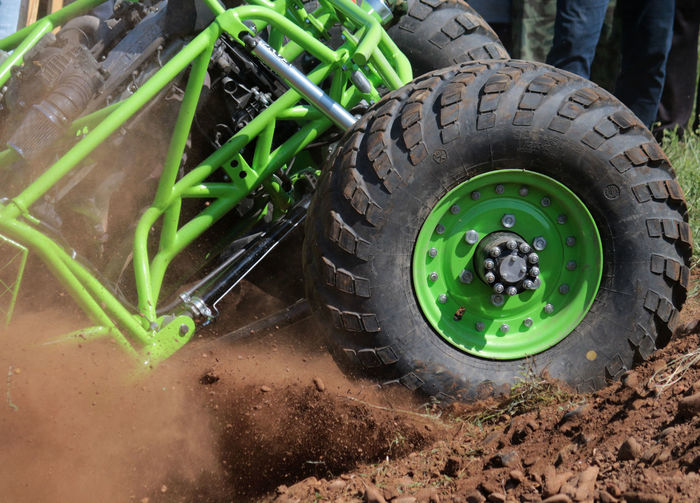 Agricultural Machinery Close-up Commercial Land Vehicle Day Green Color Jeep Land Vehicle No People Offroad Offroaddrive Offroading Outdoors Sports Teamwork Tire Transportation Wheel
