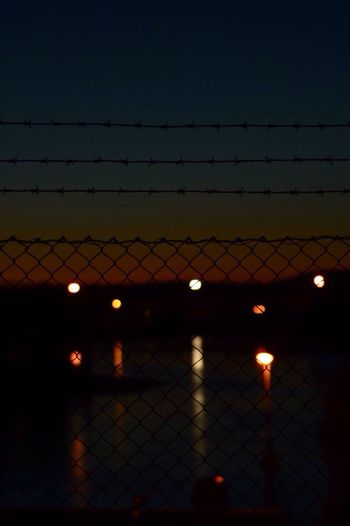 Barbed Wire Chainlink Fence Protection Safety Illuminated No People Outdoors Dusk Sky Night Sunset Clear Sky Nature Close-up EyeEm Gallery EyeEm Nature Lover EyeEm Best Shots Tranquil Scene Idyllic Tranquility Beauty In Nature EyeEm Selects