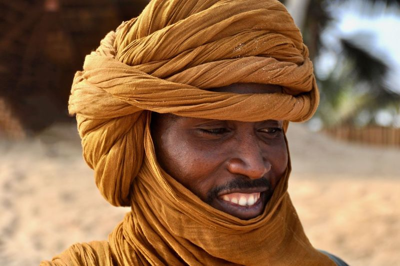Targi Itinerant People Itinerant Desert People Desert Tribe Nomadic Tribe Nomadic Life Nomadic People Portrait One Person Headshot Close-up Focus On Foreground Adult Looking At Camera Smiling Happiness Front View Emotion Human Face Africa Ghana Mali Tuareg Berber  Sahara Desert Traditional Traditional Clothes NOMAD Faces Of Africa