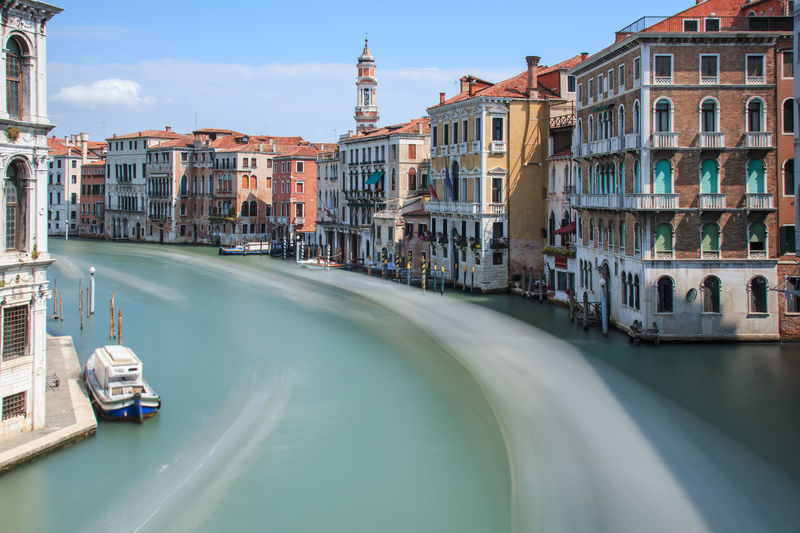 Long exposure of Grand Canal in Venice, Italy Architecture Bridge Building Building Exterior Built Structure Canal City City Life Day Gondola Ride Gondolas Grand Canal Venice Italy Long Exposure Shot Mode Of Transport Outdoors Residential Building Residential District Rialto Rialto Bridge Sky Tourism Tradition Travel Destinations Venice, Italy