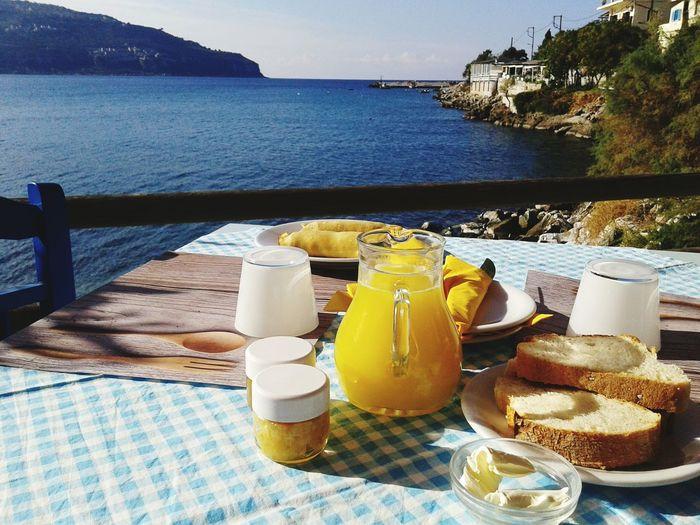Orange Juice With Breakfast On Table By Sea