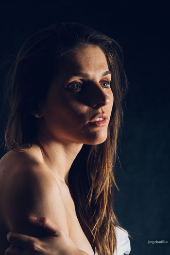 Adult Beautiful Woman Beauty Black Background Contemplation Front View Hair Hairstyle Headshot Human Face Indoors  Long Hair Looking Looking At Camera One Person Portrait Shirtless Studio Shot Women Young Adult Young Women