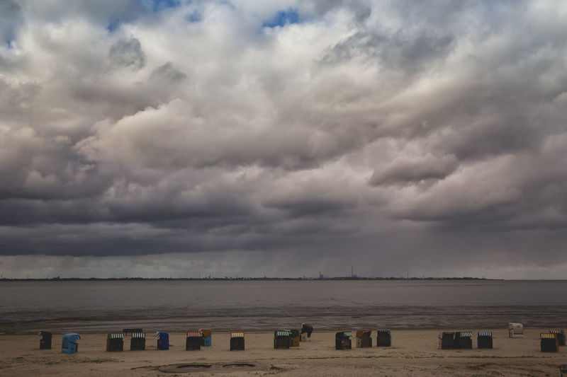 Beach Chairs German Beach Beach Chairs Beach Chairs In Germany Beauty In Nature Cloud - Sky Dangast Day Horizon Over Water Nature No People Northsea Outdoors Scenics Sea Sky Storm Cloud Tranquil Scene Tranquility Water Lost In The Landscape