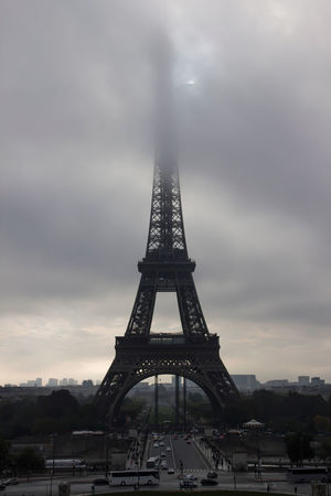 Shooting the Eiffel Tower and Trocadero on several occasions/assignments. Architecture Beautiful Light Capital Cities  Eiffel Tower Foggy Day Head Up In The Clouds International Landmark Landmark Only Partially Visible Paris Pattern Rare Weather Phenomenon Sky Steel Structure Sun Rising Against