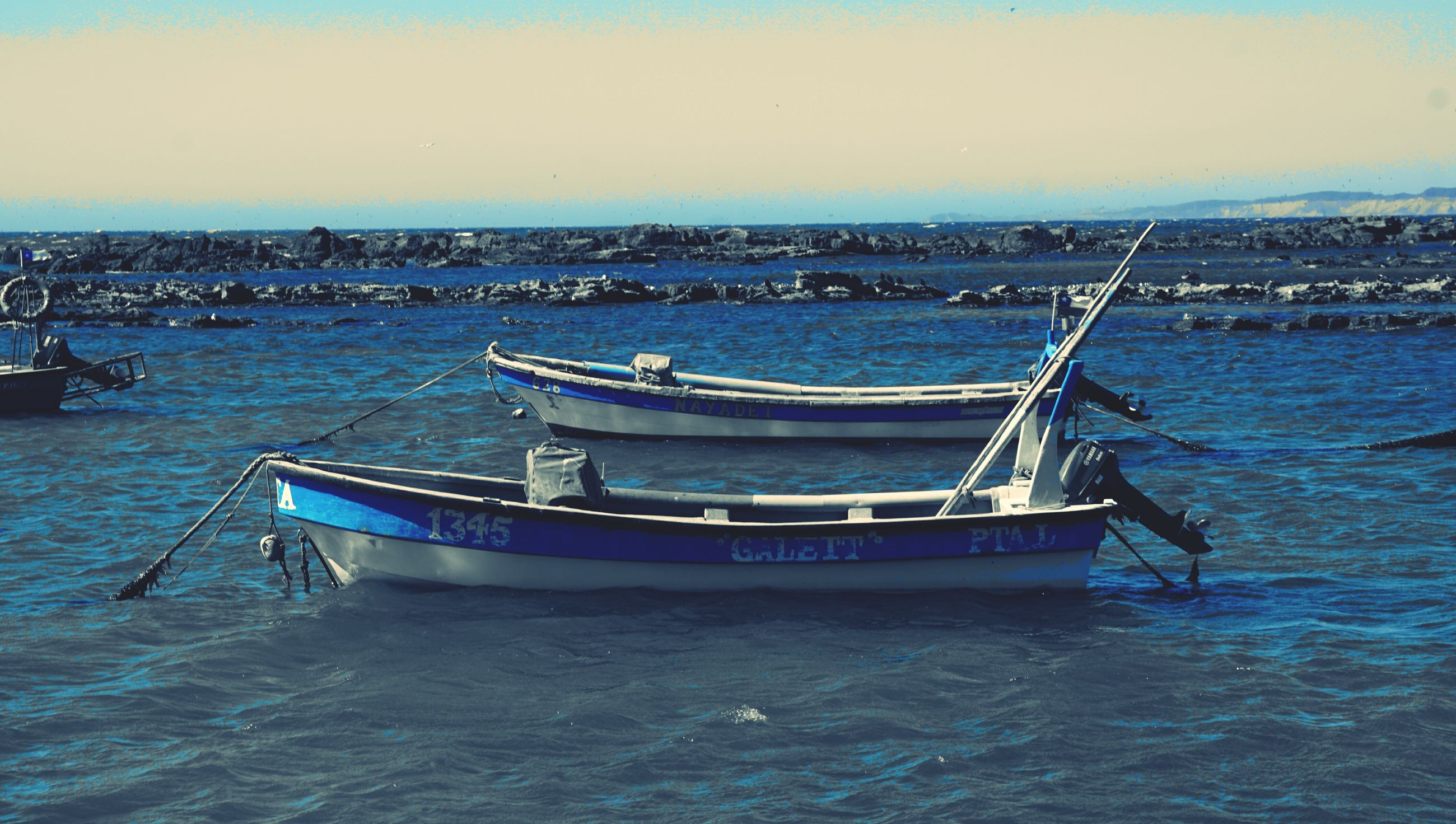water, nautical vessel, sea, boat, transportation, mode of transport, waterfront, moored, tranquility, tranquil scene, horizon over water, clear sky, rippled, nature, blue, scenics, sky, beauty in nature, day, copy space