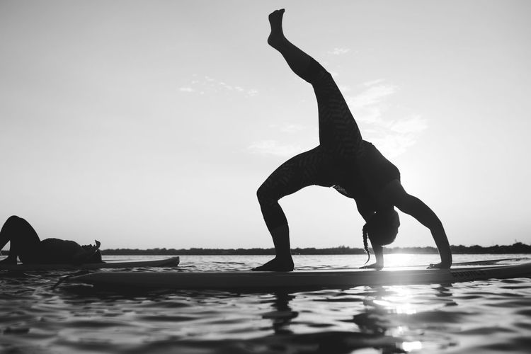 Silhouette woman on paddleboard
