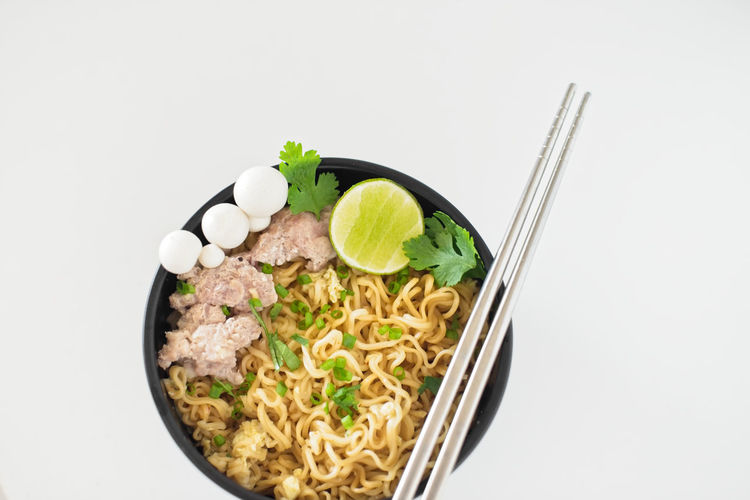 Copy Space Bowl Chopsticks Cut Out Directly Above Eating Utensil Food Food And Drink Freshness Healthy Eating Indoors  Instant Noodles Meal Mushroom No People Noodle Ramen Ready-to-eat Studio Shot Vegetable Wellbeing White Background