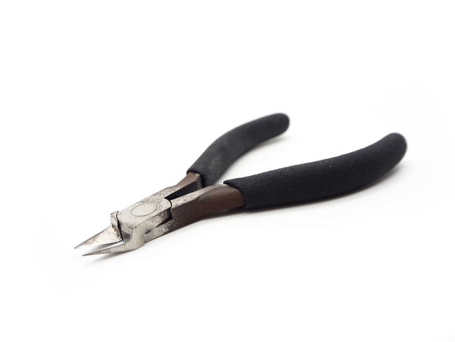 A cutting pliers for model kit isolated on white background. Black Color Close-up Communication Copy Space Cut Out Hand Tool Handle High Angle View Indoors  Metal No People Sign Single Object Steel Still Life Studio Shot Tool Weapon White Background Work Tool