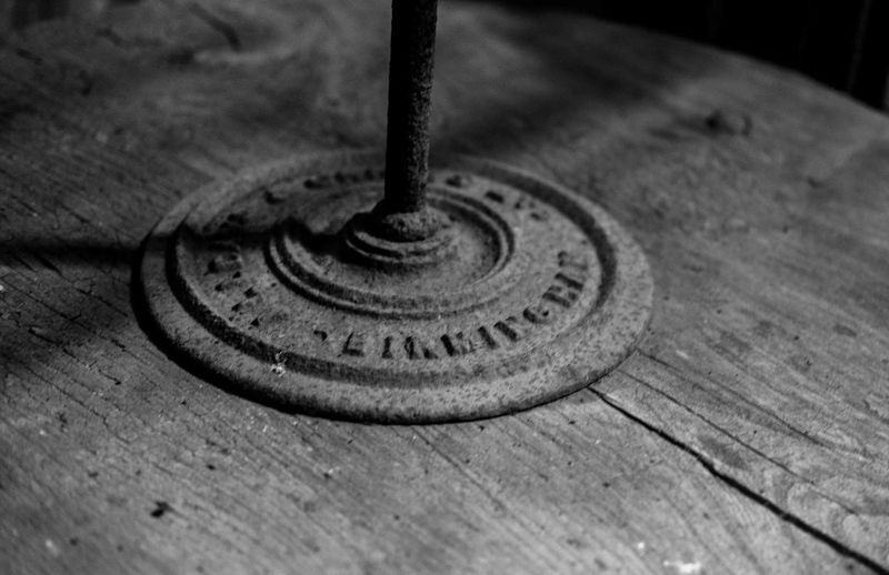 Close-up of old metal on table