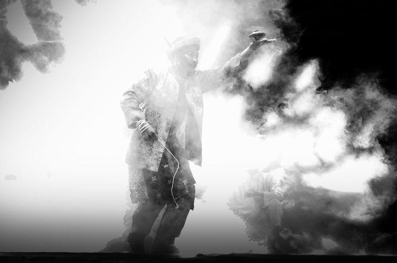 Digital composite image of man holding camera