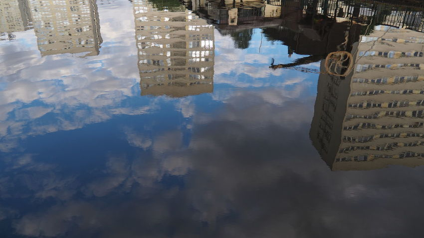 Reflection Architecture Building Building Exterior Built Structure Canal City Cloud - Sky Communication Day Digital Composite High Angle View Nature No People Office Building Exterior Puddle Reflection Sky Skyscraper Standing Water Text Water Waterfront
