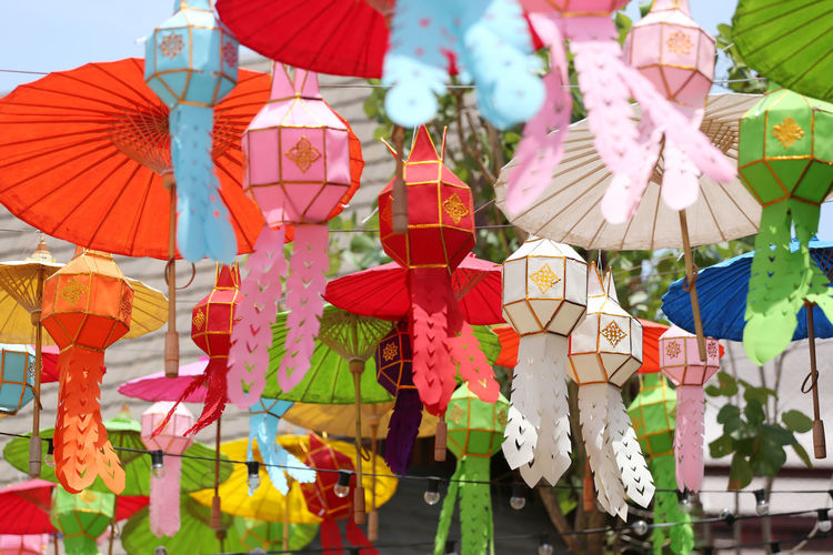 Low angle view of lanterns hanging on clothesline