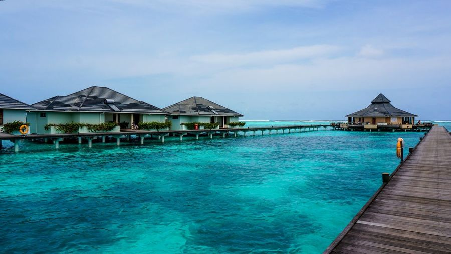 Water Travel Vacations Blue Tourist Resort Sea Sky Beauty In Nature No People Tranquility Tropical Climate Travel Destinations Scenics Outdoors Water Villa Maldives Royal Island Ocean Island