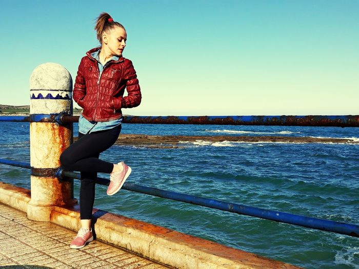 Full Length One Person Sea Standing People Water Only Women Adult Women Outdoors Red Child Clear Sky Beautiful People Beauty Real People Day Females Sky Nature