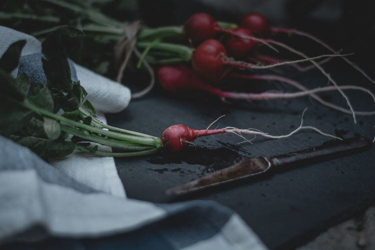 Close-up of red radishes on table