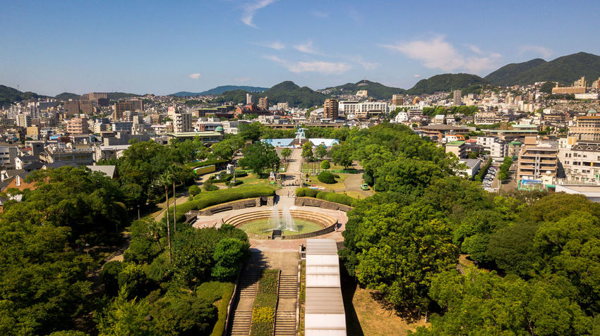 Aerial view of Nagasaki peace park in Japan. Aerial view from drone. Atomic Cityscape Japan Nagasaki Nagasaki Peace Park Peace War Memorial Architecture Beauty In Nature Bomb Building Exterior Built Structure City Day High Angle View Mountain Mountain Range Nature No People Nuclear Outdoors Park Sky Tree Water