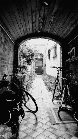 Coming Home Mode Of Transport Bicycle Transportation Built Structure Architecture Day No People Land Vehicle Stationary Doors With Stories Building Facade Hiddenplaces Door Doors House Front Building Exterior City Outdoors Architecture Black And White Friday