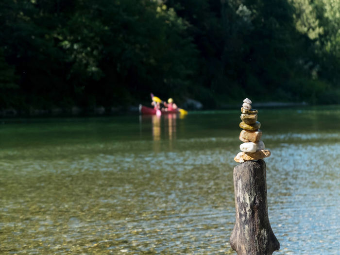 Wooden post in lake