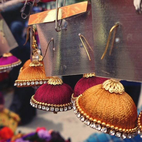 Close-up of clothes hanging for sale