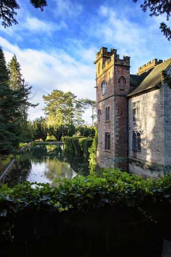 Landscape_Collection Trees Architecture Building Exterior Built Structure Cloud - Sky Day Low Angle View Moat Moated House Nature No People Outdoors Plant Reflections In The Water Sky Tree Water