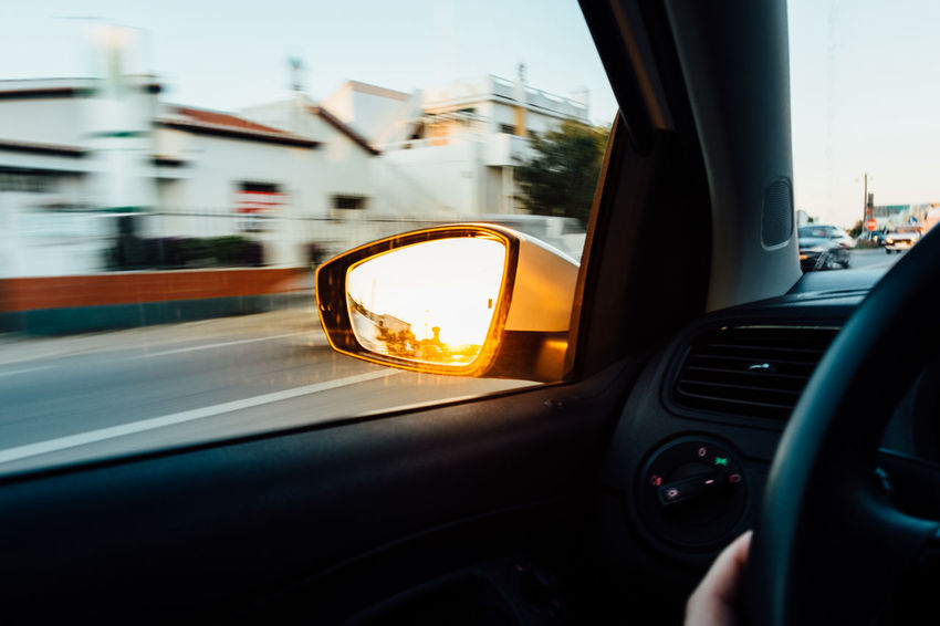 Blurred Motion Car Car Interior City Close-up Glass - Material Land Vehicle Mode Of Transportation Motion Motor Vehicle No People on the move Outdoors Reflection Road Side-view Mirror Sky Street Transportation Travel Vehicle Interior Vehicle Mirror