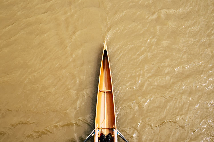 High angle view of sailboat sailing in sea