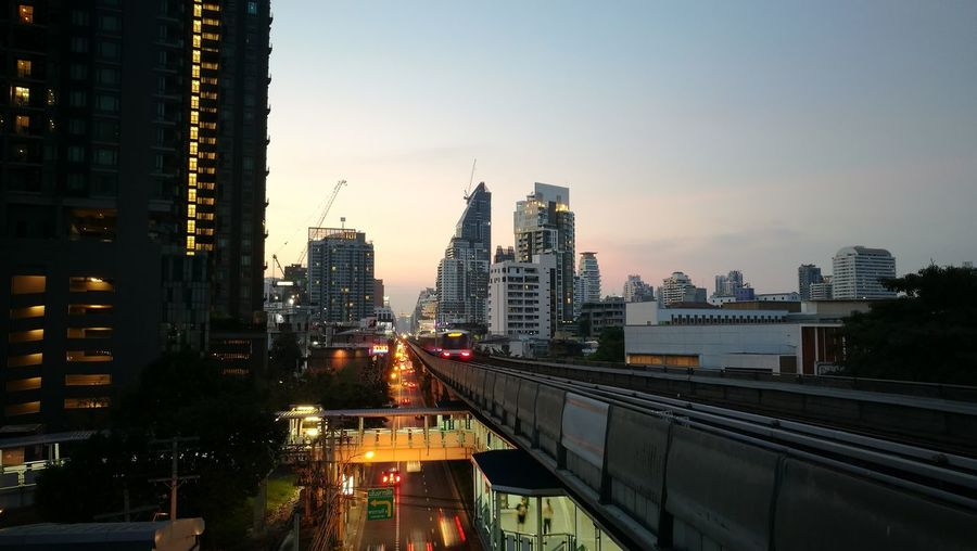 City Skyscraper Sunset Building Exterior Urban Skyline Illuminated Architecture Transportation Sky Night Traffic Bridge - Man Made Structure Cityscape Outdoors Business Finance And Industry Modern No People Urban Road Downtown District Bangkok Thailand. Office Building Exterior City Life Transportation Modern Travel Destinations