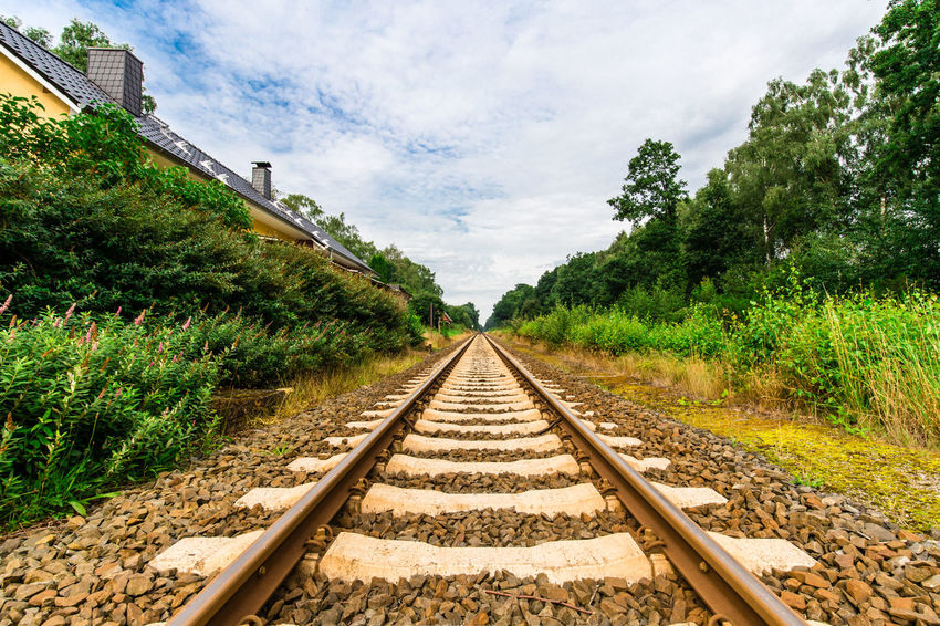 Railway Track II Forward Travel Travel Photography Trip Beauty In Nature Cloud - Sky Day Endlessness Landscape Nature No People Outdoors Plant Rail Transportation Railroad Track Railway Station Railway Track Scenics Sky Straight Forward The Way Forward Transportation Tree Trippy