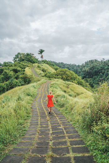 One Person Full Length Rear View Green Color Day The Way Forward Direction Beauty In Nature Real People Outdoors Walking Travel Destinations Travel Bali Red Dress Inspirational Moments Of Life Travel Moments Walking Forward Walking Alone...