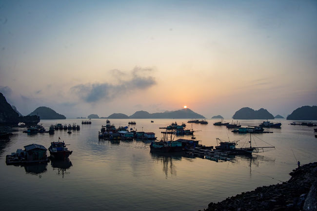traveling Vietnam 2018 ASIA Travel Traveling Vietnam Bay Beauty In Nature Cloud - Sky Explore Harbor Idyllic Marina Mode Of Transportation Moored Mountain Nature Nautical Vessel No People Outdoors Passenger Craft Scenics - Nature Sea Sky Sunset Tranquil Scene Tranquility Transportation Water Waterfront