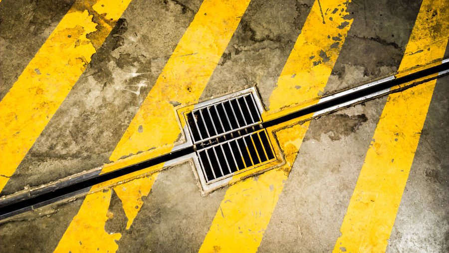 High angle view of yellow markings on road