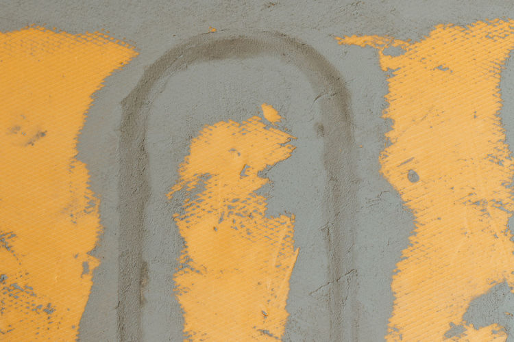 Close-up of yellow painted wall