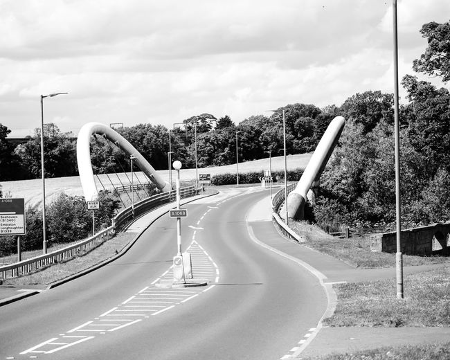 Black and white modern bridge Architecture Contempary Architecture Curve Day Metal Bridge Modern Bridge, Black And White, Nature No People Outdoors Road Sky The Way Forward Tree