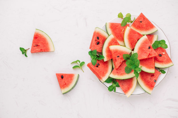 Slices of watermelon Chopped Close-up Food Food And Drink Freshness Fruit Fruit Salad Healthy Eating High Angle View Indoors  Melon No People Plate Ready-to-eat Red Ripe SLICE Still Life Table Temptation Vegetable Watermelon Wellbeing White Background
