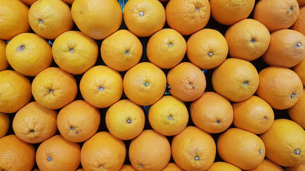 Full Frame Backgrounds No People Large Group Of Objects Food And Drink Day Freshness Fruit Outdoors Close-up Nature Healthy Eating Food Orange Color Orange Fruit