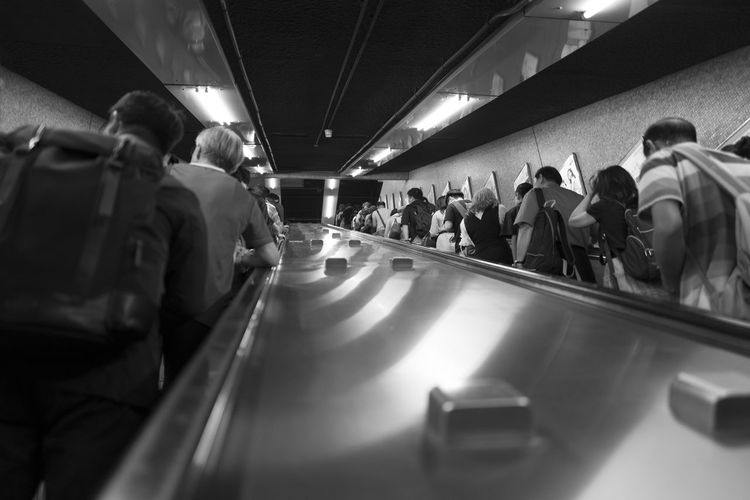 Group Of People Large Group Of People Crowd Real People Men Transportation Women Indoors  Adult Lifestyles Walking Motion Mode Of Transportation Selective Focus Public Transportation Architecture Leisure Activity Travel Standing Ceiling Waiting
