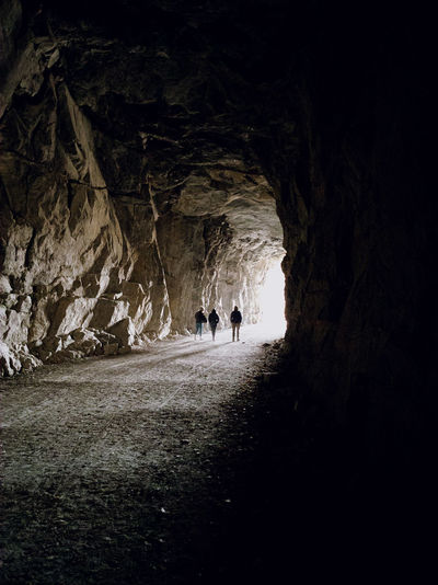People walking in cave