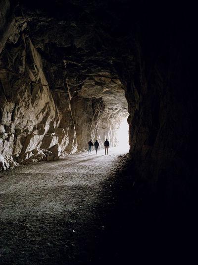 People walking in cave