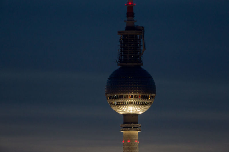Low Angle View Of Illuminated Fernsehturm Against Sky At Night