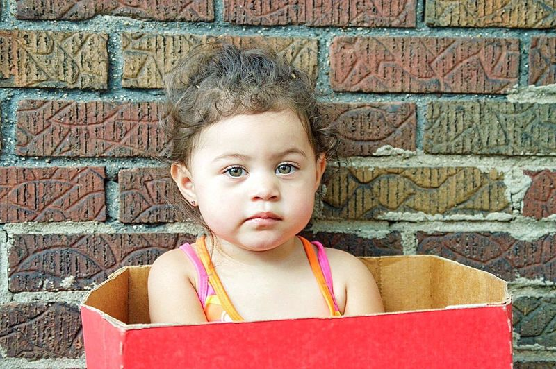 Brick Wall Looking At Camera Front View Portrait Childhood Children Only Child Outdoors One Girl Only Headshot One Person Day Home Children Cutie Settinginabox Box Bright Innocence Enjoying Life Detroit Twoyearold  Sitting Brighteyes
