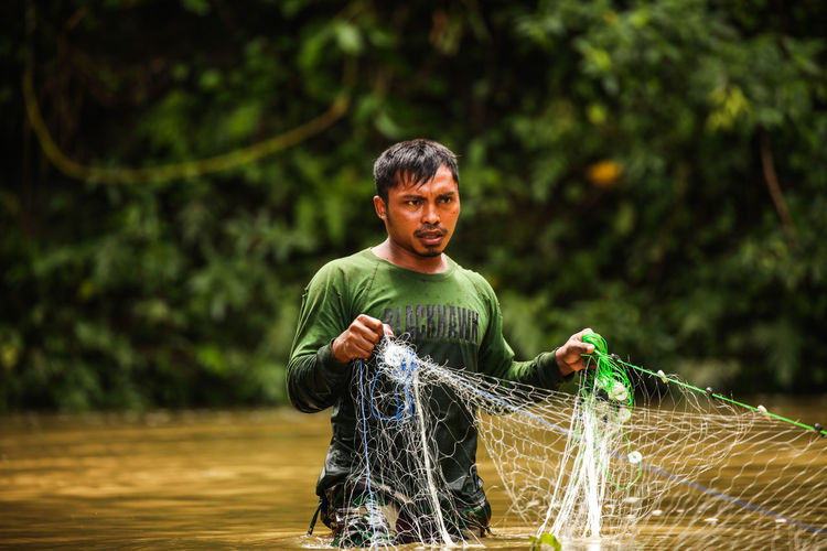 This Is Masculinity Boys Casual Clothing Day First Eyeem Photo Focus On Foreground Freshness Happiness Holding Lifestyles Motion Nature One Person Outdoors People Playing Real People Spraying Standing Tree Water