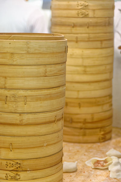 Bamboo Steamers Chinese Food Taiwanese Food Bamboo Steamer Basket Chef Chefs Close-up Commercial Kitchen Commercial Kitchens Day Dim Sum Din Tai Fung Dumpling  Dumpling Skin Dumplings Food Food And Drink Food Preparation Freshness Indoors  Kitchen No People Steamed  Steamed Dumplings Table Wood - Material Yellow