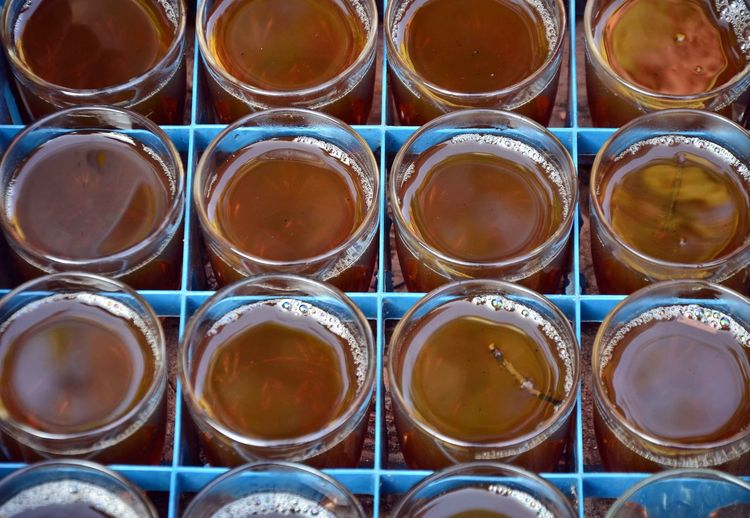 Close-up of tea glasses in crate