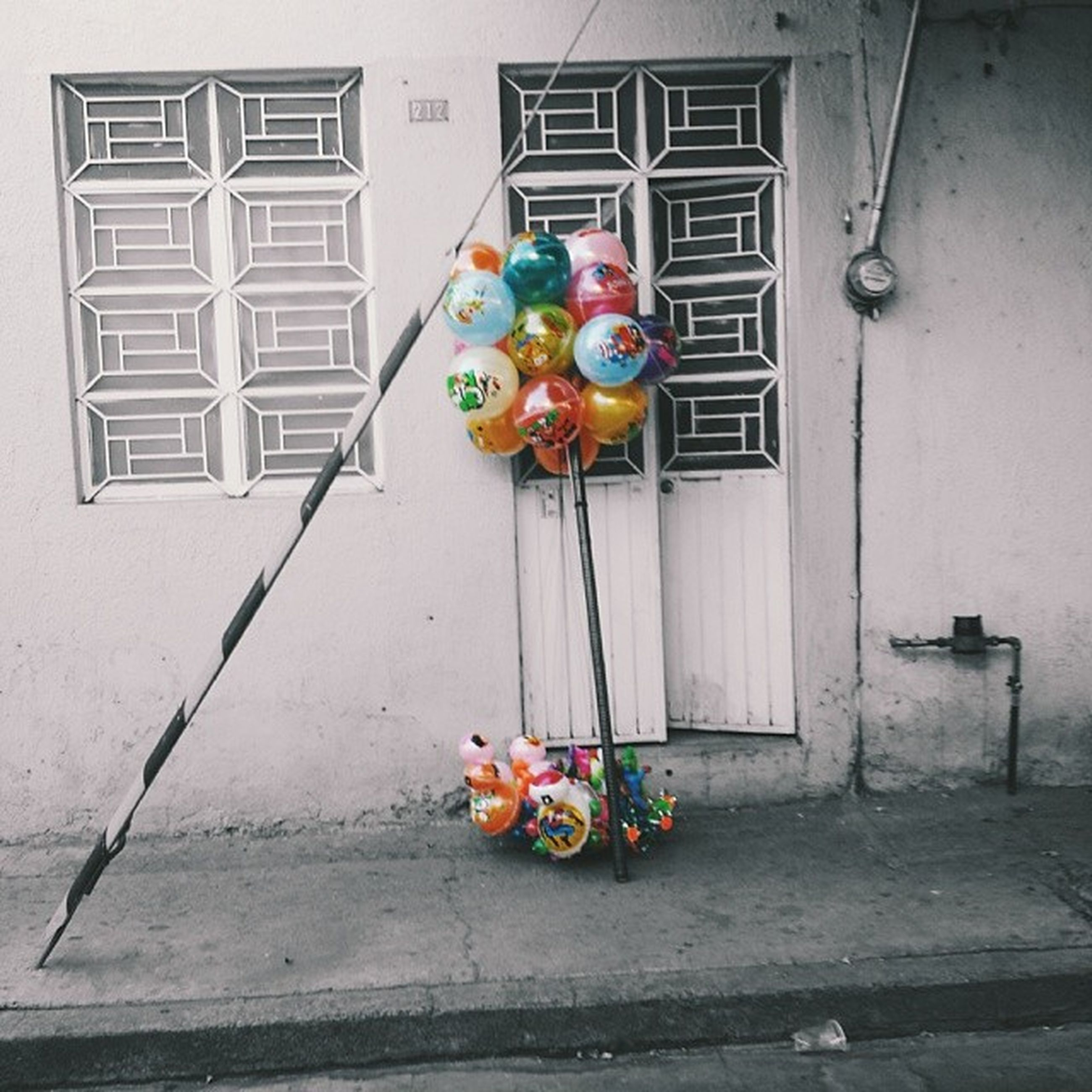 multi colored, building exterior, built structure, architecture, toy, childhood, art and craft, art, colorful, creativity, variation, hanging, day, wall - building feature, house, window, no people, outdoors, animal representation, street