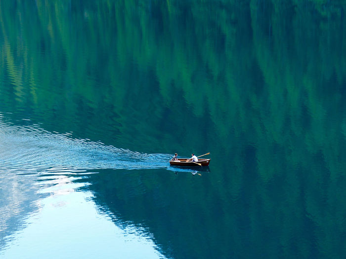High angle view of boat sailing in lake
