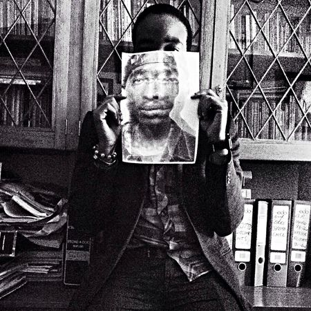 Xhanti Jafta holding a picture of Tupac. Getting In Touch Visualtelepathy Tocamepicture