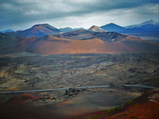 Lanzarote Colored Earth Dry Landscape Timanfaya National Park Beauty In Nature Day Landscape Lava Mountain Mountain Range Nature No People Outdoors Surreal Tranquil Scene Tranquility Volcanic Landscape
