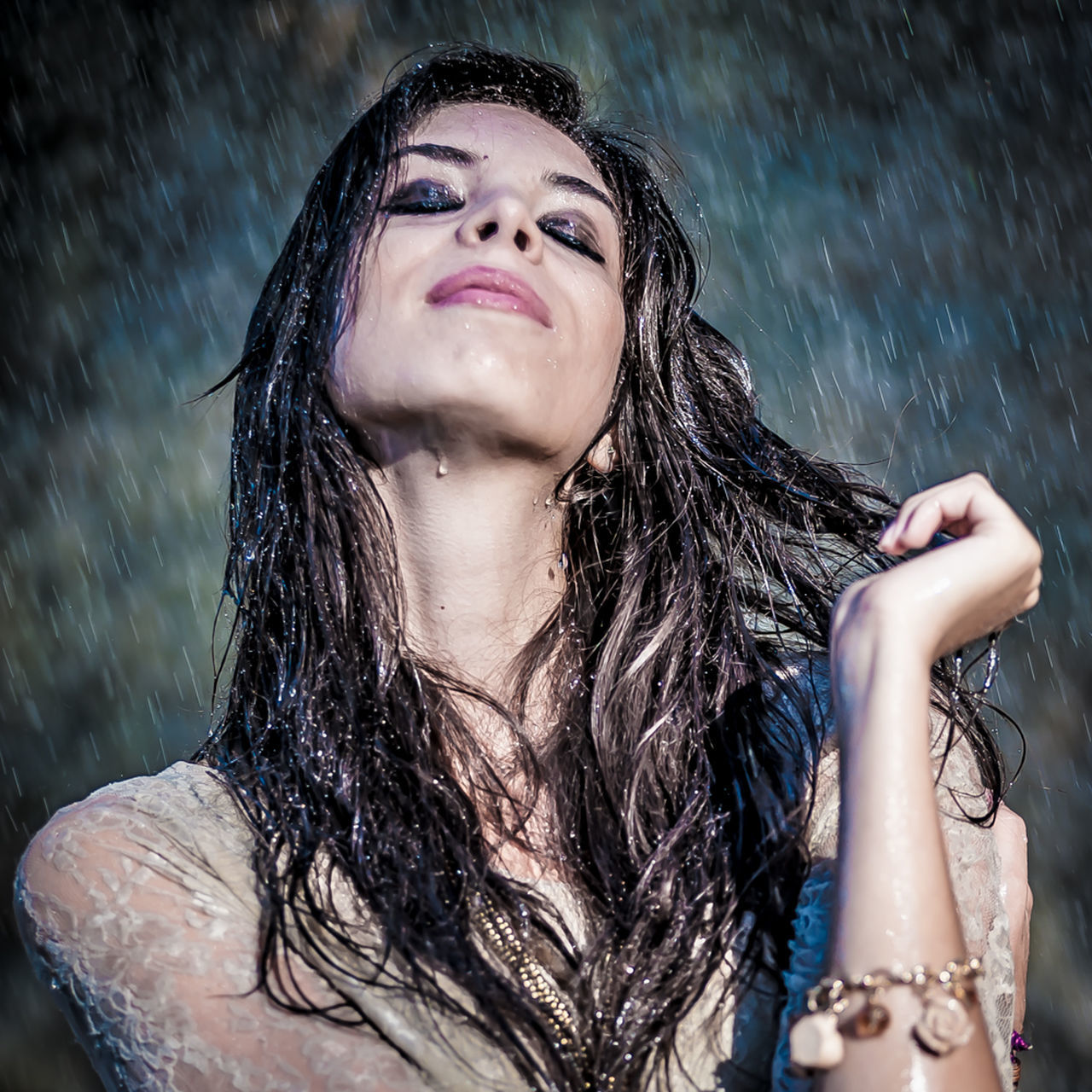 wet, rain, water, weather, drop, wet hair, raindrop, rainy season, shower, refreshment, splashing, motion, storm, outdoors, happiness, torrential rain, real people, focus on foreground, lifestyles, leisure activity, nature, young women, one person, cold temperature, day, young adult, spraying, beautiful woman, close-up, dripping, people