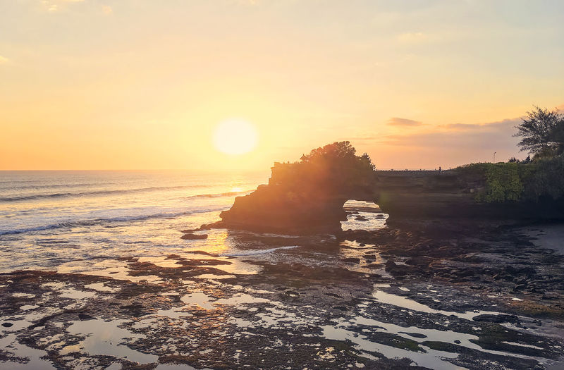 Batu Bolong in Bali, Indonesia at sunset ASIA Bali Batu Bolong Holiday INDONESIA Sunlight Beach Beauty In Nature Day Horizon Over Water Idyllic Nature Outdoors Scenics Sea Sky Sun Sunlight Sunset Tanah Lot Temple Tranquil Scene Tranquility Vacation Water